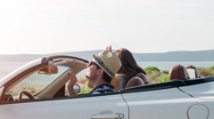 Happy Man And Woman Arrive At Beach In Convertible Car Happy Holiday Vacation Stock Footage