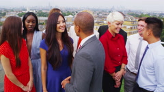 4K Portrait of attractive smiling business team with city view in the background Stock Footage