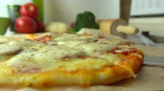 Cooking, part of the set. Taking a piece of freshly baked homemade pizza with Stock Footage