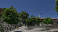 Tourist exploring the courtyard of the Great Meteoron Monastery in Meteora Stock Footage