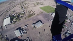 Professional skydiver landing on green field in Arizona. Sunny day. Extreme Stock Footage