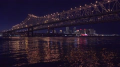 Beautiful shot of the Crescent City Bridge at night with New Orleans Louisiana Stock Footage
