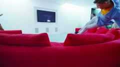 4K Excited friends rush to take a seat in luxurious home television viewing area Arkistovideo