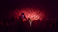 New Years Eve Crowd Watching Fireworks Recording On Smartphone Taking Pictures Stock Footage