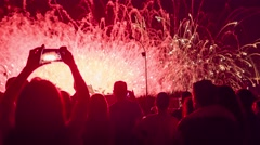 Happy Crowd Silhouettes Watching Fireworks Display Taking Photos With Smartphone Stock Footage