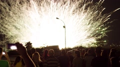 TARRAGONA, SPAIN - CIRCA JULY 2016 - People watch fireworks and record it on Stock Footage