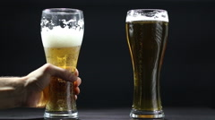 Two gold beer glasses Stock Footage