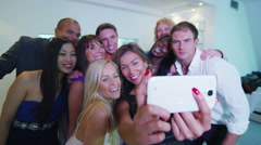 4K Happy friends having fun in nightclub pose for selfie with camera phone Stock Footage