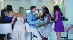 4K Attractive couple talking & flirting at the bar in nightclub Stock Footage