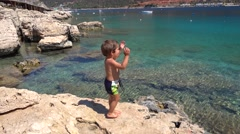Child gets very excited seeing stunning sea Stock Footage