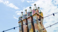 BARCELONA, SPAIN - CIRCA JULY 2016: Casa Battlo rooftop chimneys by Gaudi Stock Footage