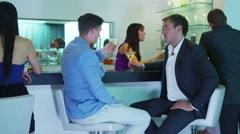 4K Friends or businessmen drinking cocktails & shaking hands in nightclub Stock Footage