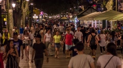 BARCELONA, SPAIN - CIRCA JULY 2016: People on La Rambla street walking in slow Stock Footage