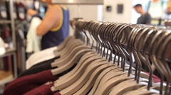 Close Up on Hangers with Clothes in Shopping Mall Stock Footage