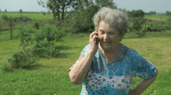 Old woman 80s telling on the smartphone outdoors Stock Footage