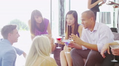 4K Portrait smiling man at elegant party, socializing & drinking with friends Stock Footage