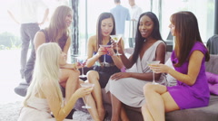4K Portrait smiling female friends drinking cocktails at summer party Stock Footage