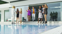 4K Happy friends socializing at elegant summer party Stock Footage