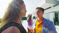 4K Happy friends socializing at summer party, young couple chatting by the pool  Stock Footage