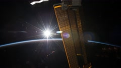 February: ISS panning view of Earth with Moon rising and setting Stock Footage