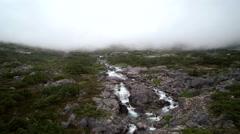 Misty Alpine Cascading Waterfall Reverse Descending Aerial Stock Footage