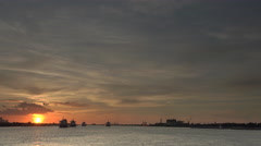 Cruising on Mississippi at sunset passing by cargo ships Stock Footage