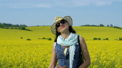 Woman on field smiling to the camera, steadycam shot, slow motion shot at 240fps Stock Footage