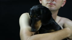 Man and his dog breed dachshund Stock Footage