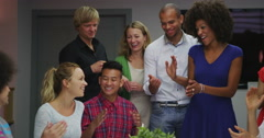 Cheerful creative business group in a meeting applaud one member of the team Stock Footage