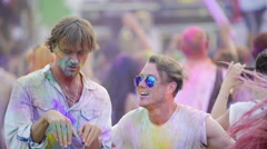 Happy guys jumping and dancing to music at concert, joking and laughing together Stock Footage