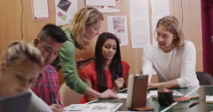 Students being taught by a teacher at an adult education center Stock Footage