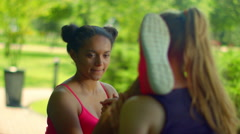 Multiracial girl stretching legs. Trainer helping biracial girl in stretching Stock Footage