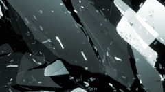Pieces of splitted or cracked glass in slow motion. Alpha matte Stock Footage
