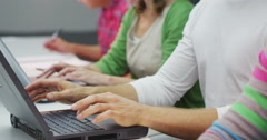 Casual business group or students, working side by side on laptop computers Stock Footage