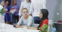 Young casual business team brainstorming and sharing ideas in creative office. Stock Footage