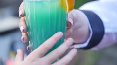 Blue Coctail glass in hand Stock Footage
