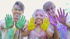 Happy young people waving colorful palms to camera, charity event promotion Stock Footage