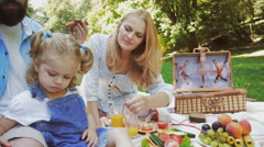 Young family having picnic outdoors Stock Footage
