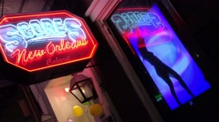 Scores sports club in New orleans features dancing lady on the sign. Stock Footage