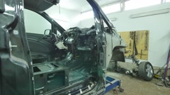 Dismantled front of a car in the garage Stock Footage