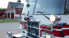 Fire engines leaving the fire department, close up Stock Footage