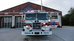 Fire engine with lights on at the fire department Stock Footage