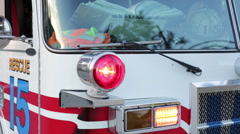 Fire engine with lights on at the fire department, close up Stock Footage