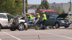 Firefighters rescue people at car accident in city intersection Stock Footage