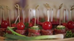 A table spread with delicious finger foods Stock Footage