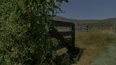 Wild West horse corral pasture mountains sky trek Stock Footage
