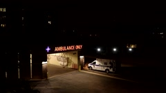 Ambulance Arriving at ER at Night Stock Footage