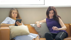 Co-working females are working with tablet pc having break Stock Footage