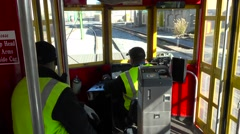 Point of view shot looking through a New Orleans streetcar as it travels through Stock Footage