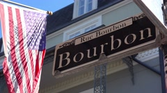 Bourbon Street sign, French Quarter, New Orleans with American flag. Stock Footage